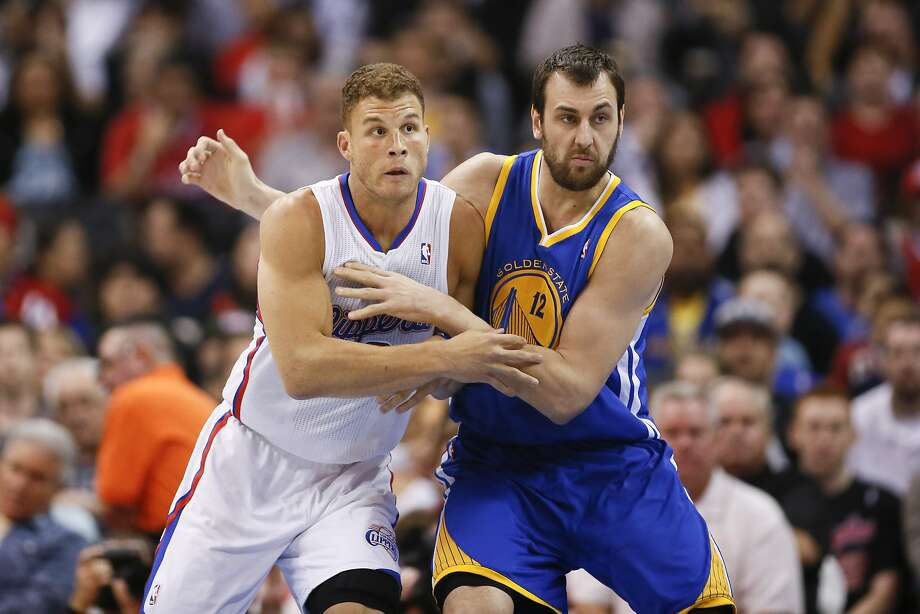 Golden State Warriors' Andrew Bogut and Los Angeles Clippers' Blake Griffin battle for position during the first half of an NBA basketball game in Los Angeles, Wednesday, March 12, 2014. (AP Photo/Danny Moloshok) Photo: Danny Moloshok, Associated Press