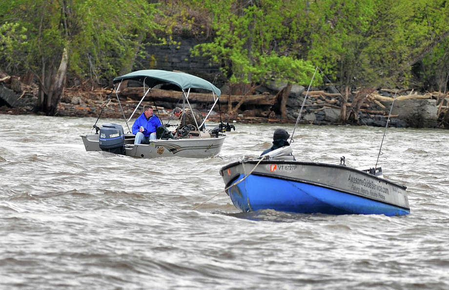 Battling high winds and flood water, small boats try for stripers in the Hudson River at Green Island Thursday afternoon May 5, 2011.   (John Carl D'Annibale / Times Union) Photo: John Carl D'Annibale
