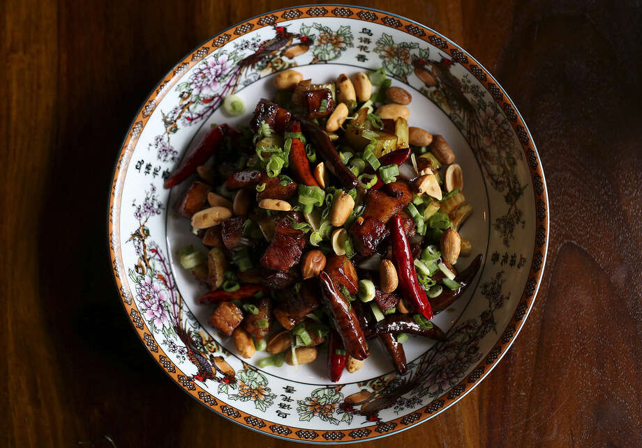 Bacon, first smoked at Two Bros. BBQ Market, is tossed in a kung pao sauce with dates, green onions, peanuts, celery and chiles to make the Kung Pao Bacon. Photo: Photos By Lisa Krantz / San Antonio Express-News / SAN ANTONIO EXPRESS-NEWS
