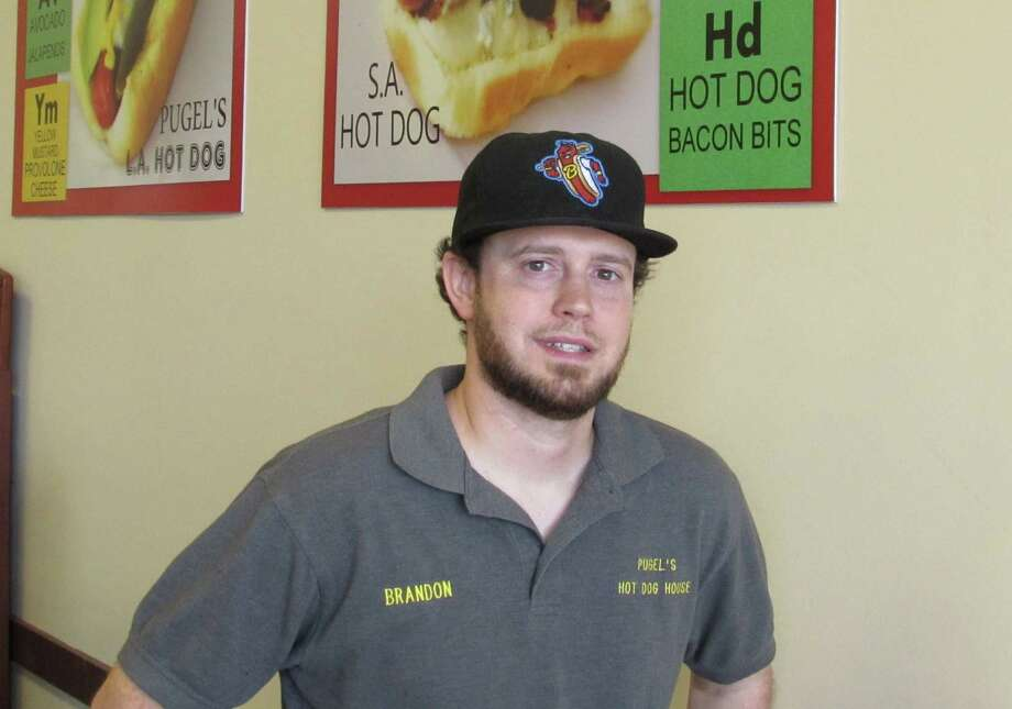 Brandon Pugel is part-owner and general manager of the Original San Antonio Hot Dog House. Photo: Burt Henry / San Antonio Express-News