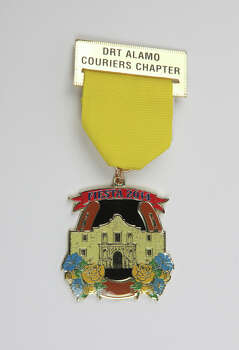 Daughters of the Republic of Texas, Alamo Couriers Chapter's 2014 medal, $8, at the Fiesta Store, commemorates the couriers who risked their lives in and out of the Alamo in March 1836, www.facebook.com/drtalamocouriers. Photo: Juanito M. Garza, San Antonio Express-News / San Antonio Express-News