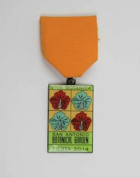 San Antonio Botanical Garden's Viva Botanica! Fiesta Medal, $7, at the Fiesta Store and the garden's offices, 555 Funston Place, www.sabot.org. Photo: Juanito M. Garza, San Antonio Express-News / San Antonio Express-News
