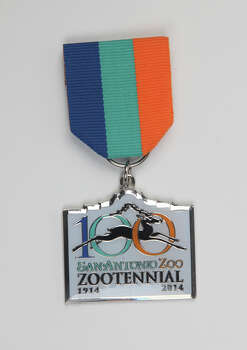 San Antonio Zoo's Zootennial Fiesta Medal, $12, on sale at the zoo's gift shop, 3093 N. St. Mary's St.,  www.sazoo-aq.org. Photo: Juanito M. Garza, San Antonio Express-News / San Antonio Express-News