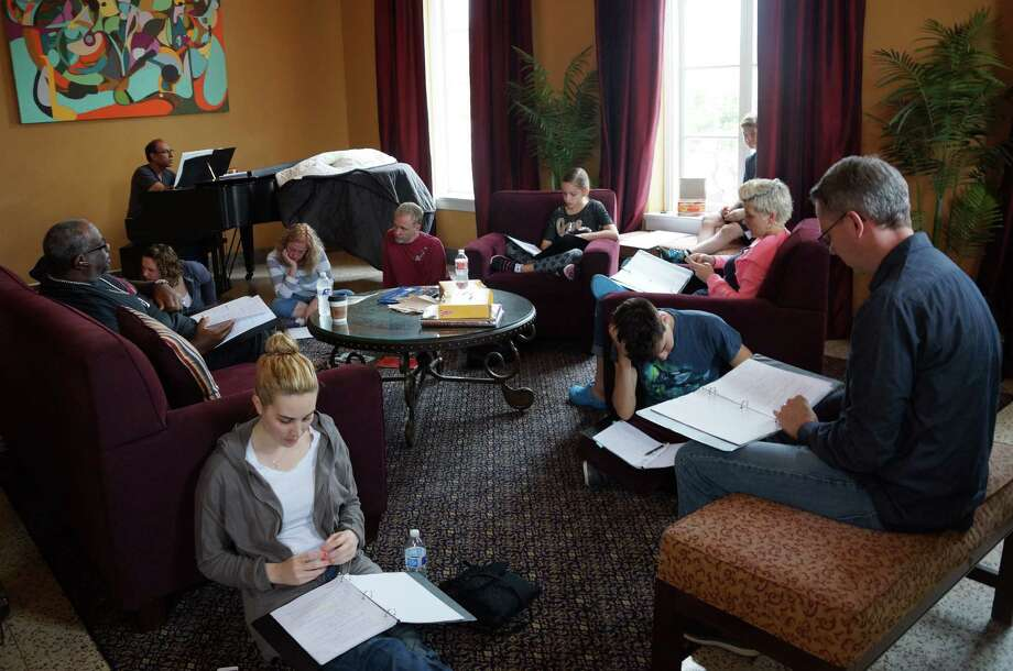 "The cast of the staged readings for ""Region 8,"" a pilot based on experiences in the local foster care system, rehearses in the lobby of the Playhouse San Antonio. Photo: Courtesy Shannon Ivey"