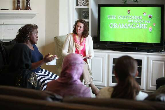 Cynthia Ginyard introduces herself to the group during the Affordable Care Act gathering where attendees learn about options before Monday's deadline on March 26, 2014, in Sugar Land, Tx. ( Mayra Beltran / Houston Chronicle )