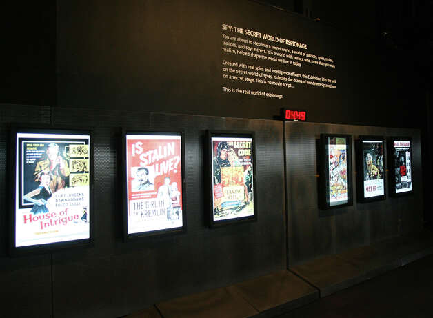 """Hollywood spy movie posters are shown during a preview of """"SPY: The Secret World of Espionage"""" on March 27, 2014 at the Pacific Science Center in Seattle. Photo: AUBREY COHEN, SEATTLEPI.COM"""