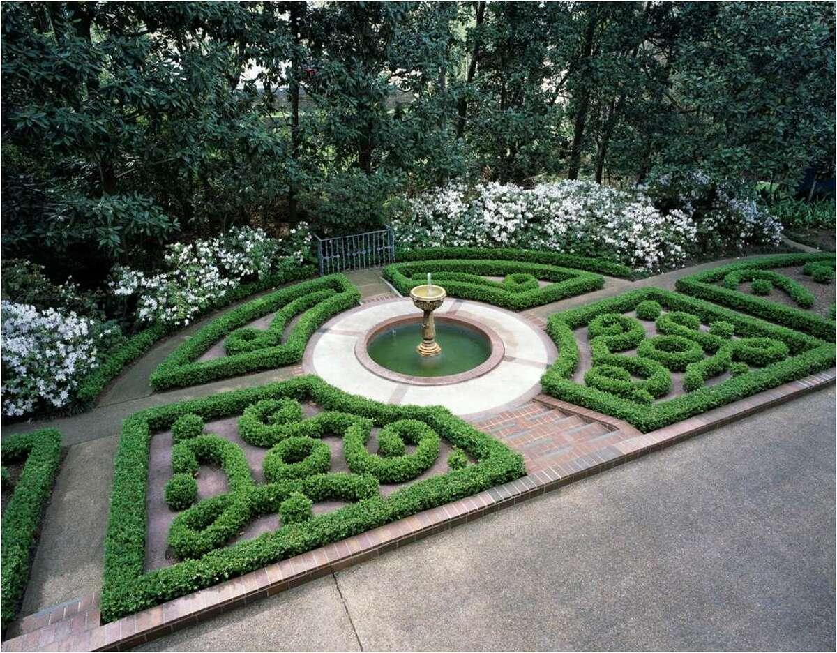 Formal gardens surround a fountain at the Rienzi Gardens in Houston.