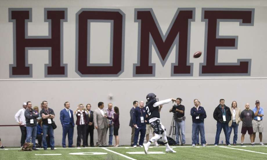 Johnny Manziel throws a pass during his pro day. Photo: Brett Coomer, Houston Chronicle