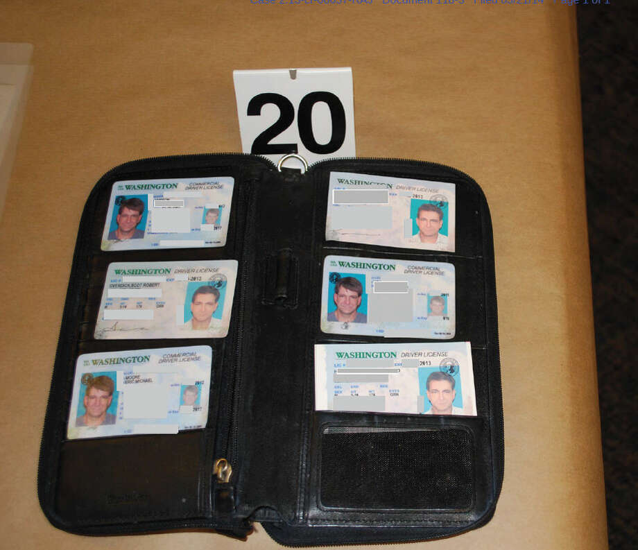Ids depicting Michael Suryan's recovered from his Shoreline hotel room. Photo: Justice Department Photos