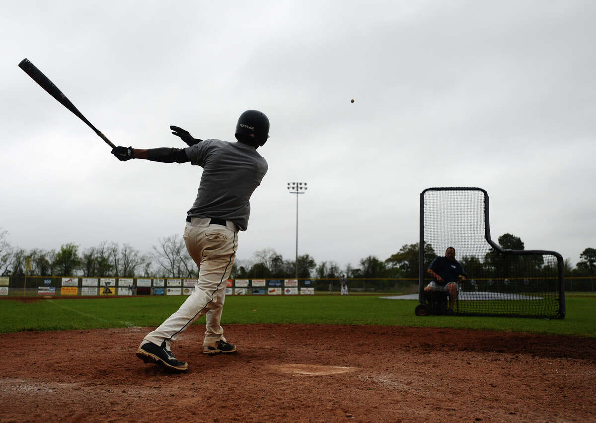 Aidan Anderson sends a ball toward the outfield during practice Thursday afternoon. The West Orange-Stark High School baseball team practiced despite the threat of rain Thursday afternoon. Photo taken Thursday, 3/27/14 Jake Daniels/@JakeD_in_SETX