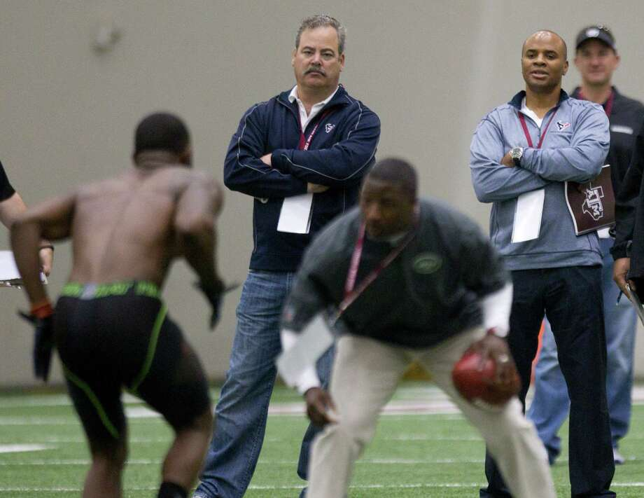 Among the Texans' brass who will determine the all-important No. 1 overall pick are COO Cal McNair, center, and general manager Rick Smith, both of whom were on hand for Johnny Manziel's pro day in March. Photo: Brett Coomer, Houston Chronicle / © 2014 Houston Chronicle