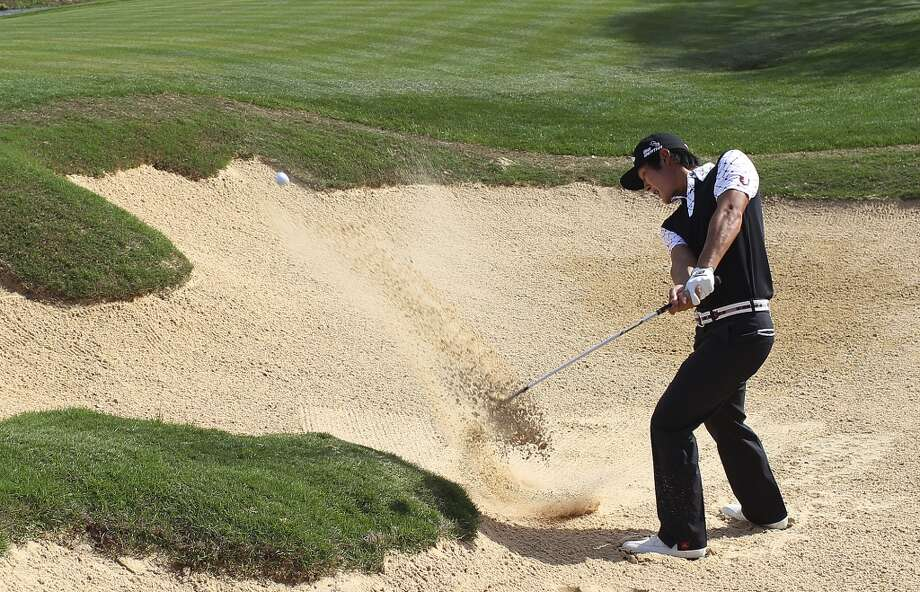 Danny Lee, of Rotorua, New Zealand, blast out of an 18th hole bunker during the first round of the 2014 Valero Texas Open at TPC San Antonio, Thursday, March 27, 2014. Lee birdied the hole and tied for the lead at 4-under with Pat Perez of Scottsdale, Arizona. Photo: Jerry Lara, San Antonio Express-News