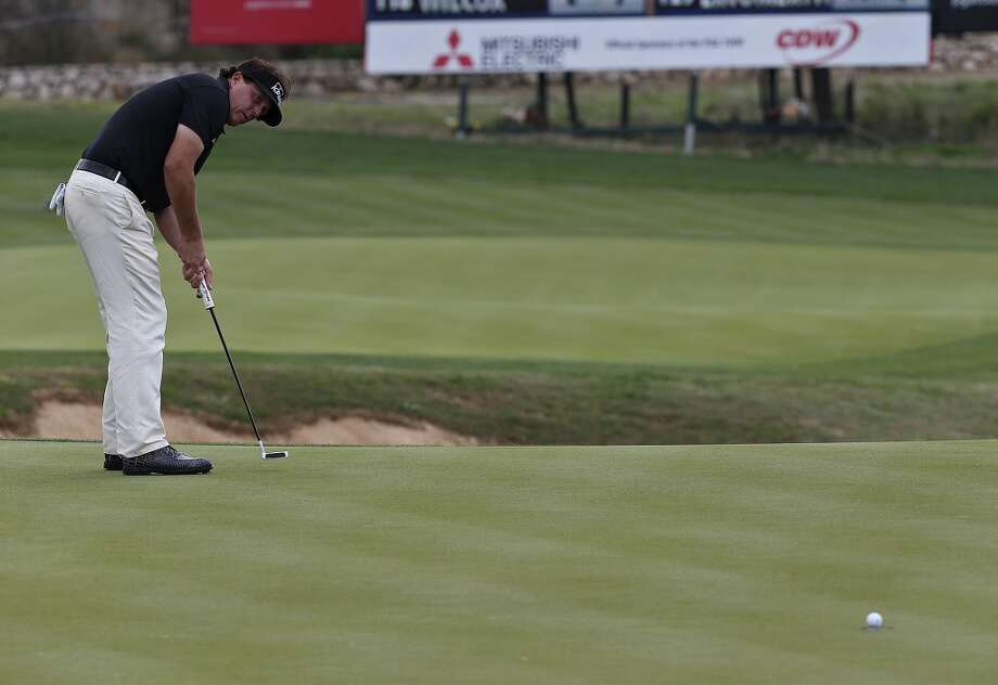 Phil Mickelson, of Rancho Santa Fe, California, watches as his putt reams out on the number 2 green during the first round of the 2014 Valero Texas Open at TPC San Antonio, Thursday, March 27, 2014. Mickelson ended the day at 5-over par. Photo: Jerry Lara, San Antonio Express-News