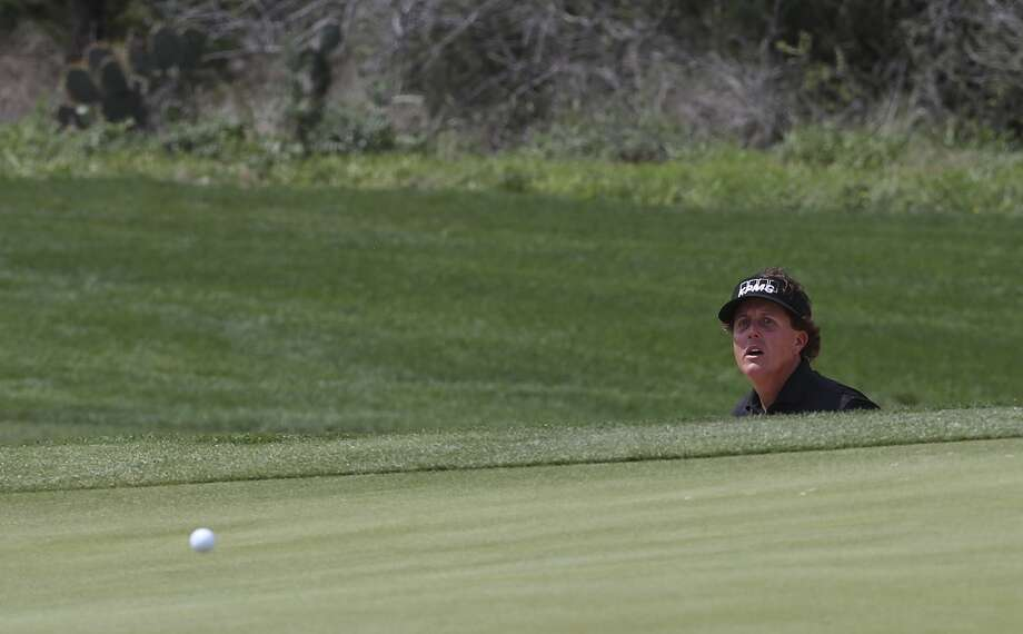 Phil Mickelson, of Rancho Santa Fe, California, watches his shot on the number 6 green during the first round of the 2014 Valero Texas Open at TPC San Antonio, Thursday, March 27, 2014. Photo: Jerry Lara, San Antonio Express-News