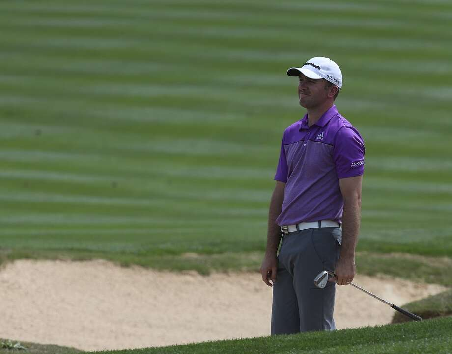 Returning champion Martin Laird of Glasgow, Scotland, reacts to a bunker shot by the 8th green during the first round of the 2014 Valero Texas Open at TPC San Antonio, Thursday, March 27, 2014. Photo: Jerry Lara, San Antonio Express-News