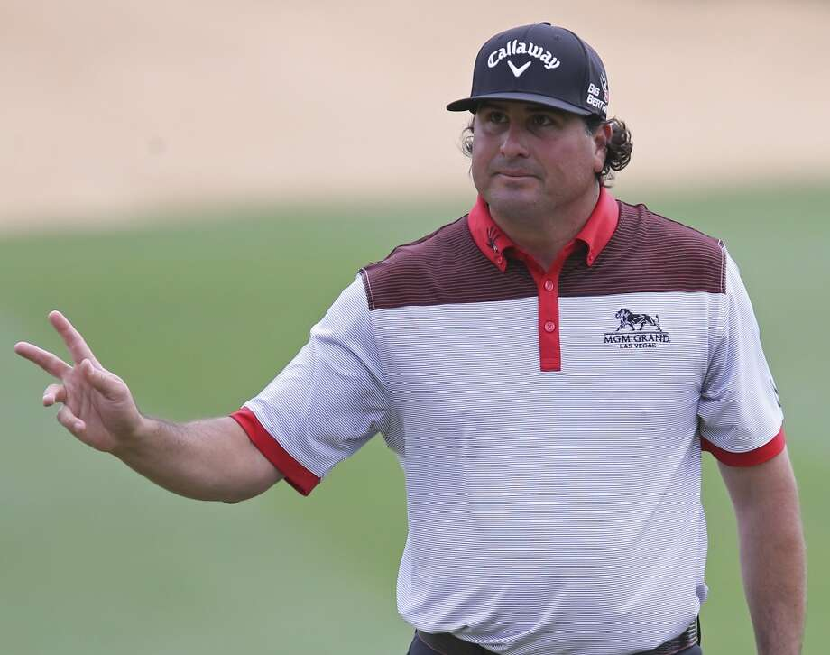 Pat Perez waves to the gallery after making a birdie putt on No. 18 during the first round of the 2014 Valero Texas Open Thursday March 27, 2014 at TPC San Antonio. Photo: Edward A. Ornelas, San Antonio Express-News