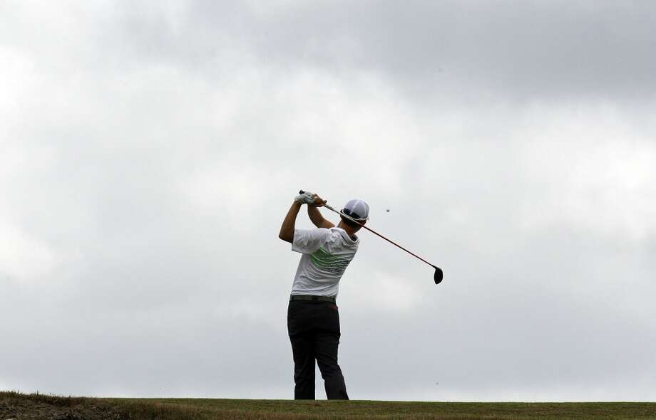 Seung-Yul Noh hits his tee shot on No. 11 during the first round of the 2014 Valero Texas Open Thursday March 27, 2014 at TPC San Antonio. Photo: Edward A. Ornelas, San Antonio Express-News