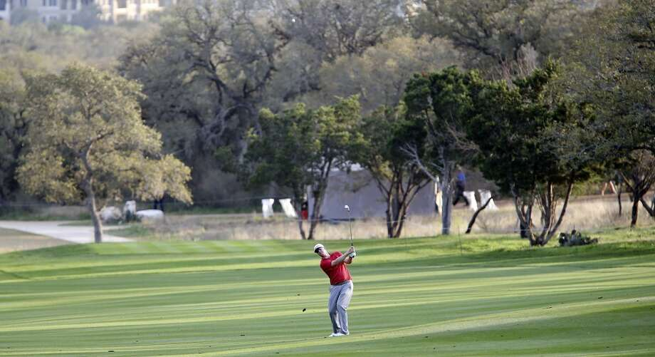 Justin Hicks hits his approach shot on No. 12 during the first round of the 2014 Valero Texas Open Thursday March 27, 2014 at TPC San Antonio. Photo: Edward A. Ornelas, San Antonio Express-News