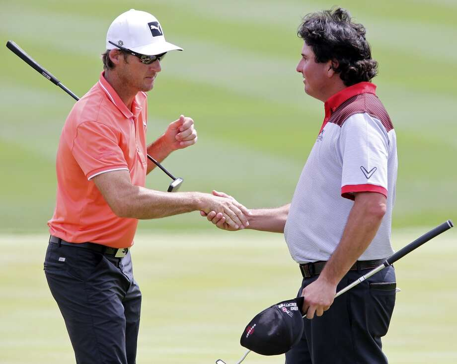 Will MacKenzie (left) and Pat Perez shake hands after their first round of the 2014 Valero Texas Open Thursday March 27, 2014 at TPC San Antonio. Photo: Edward A. Ornelas, San Antonio Express-News