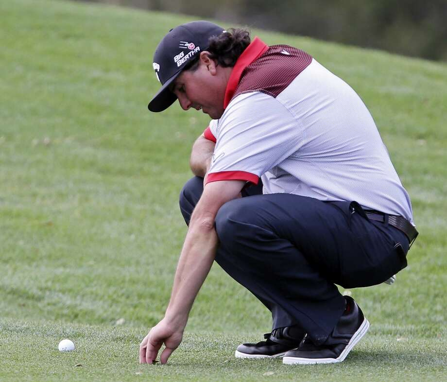 Pat Perez eyes his fairway lie on No. 18 during the first round of the 2014 Valero Texas Open Thursday March 27, 2014 at TPC San Antonio. Photo: Edward A. Ornelas, San Antonio Express-News