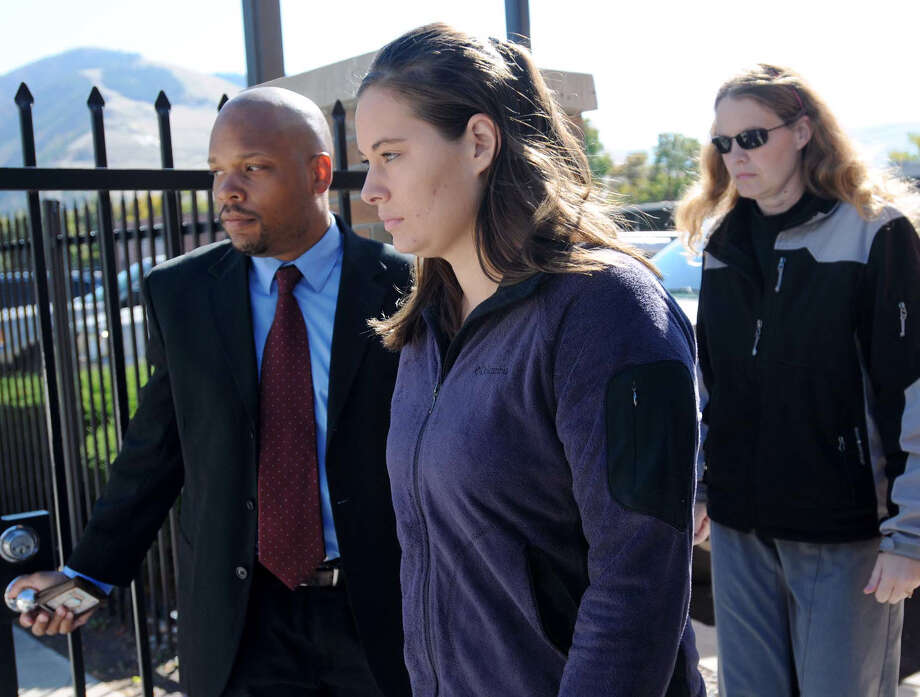 Jordan Graham (center) is sentenced for pushing her new husband off a cliff to his death. Photo: Michael Gallacher / Associated Press / The Missoulian