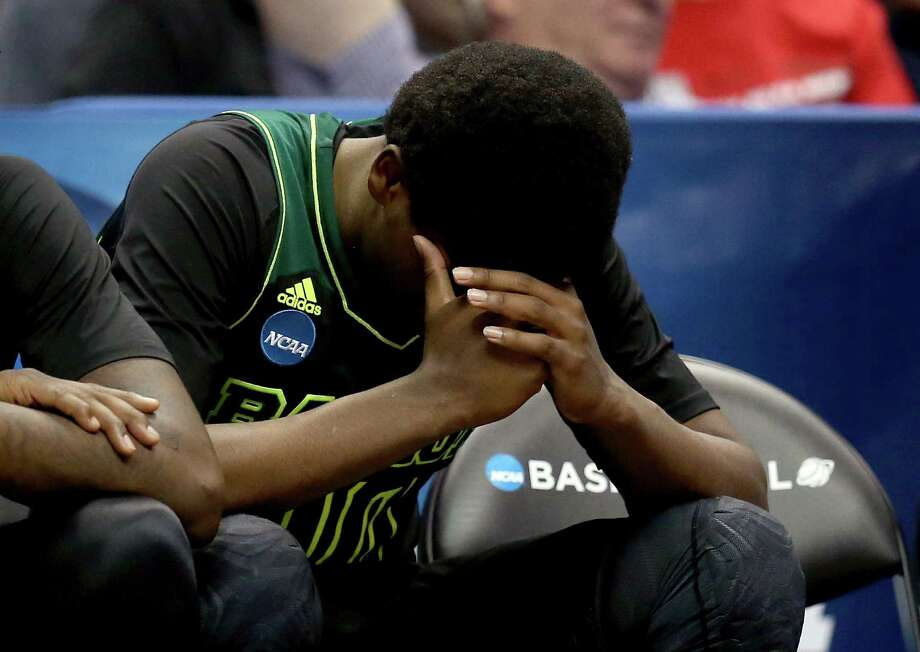 ANAHEIM, CA - MARCH 27:  Royce O'Neale #00 of the Baylor Bears sits on the bench late in the second half while taking on the Wisconsin Badgers during the regional semifinal of the 2014 NCAA Men's Basketball Tournament at the Honda Center on March 27, 2014 in Anaheim, California. Photo: Jeff Gross, Getty Images / 2014 Getty Images