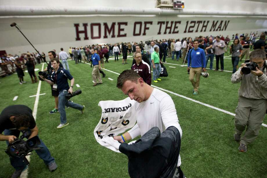 Former Texas A&M quarterback Johnny Manziel attracted a crowd before, during and after his pro day Thursday in College Station. Photo: Brett Coomer, Houston Chronicle / © 2014 Houston Chronicle