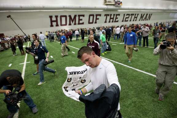Former Texas A&M quarterback Johnny Manziel attracted a crowd before, during and after his pro day Thursday in College Station.
