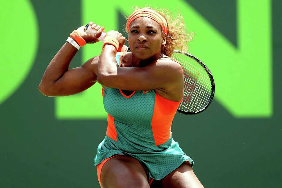KEY BISCAYNE, FL - MARCH 27:  Serena Williams returns a shot to Maria Sharapova of Russia during the Sony Open at the Crandon Park Tennis Center on March 27, 2014 in Key Biscayne, Florida.  (Photo by Matthew Stockman/Getty Images) ORG XMIT: 479810863 Photo: Matthew Stockman / 2014 Getty Images