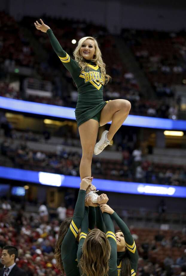 A Baylor cheerleader performs during a regional semifinal NCAA college basketball tournament game against Wisconsin, Thursday, March 27, 2014, in Anaheim, Calif. Photo: Jae C. Hong, Associated Press