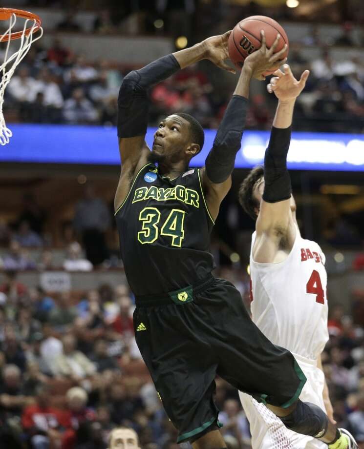 Wisconsin forward Frank Kaminsky right, can't stop Baylor forward Cory Jefferson (34) from dunking during the second half of an NCAA men's college basketball tournament regional semifinal, Thursday, March 27, 2014, in Anaheim, Calif. Photo: Jae C. Hong, Associated Press