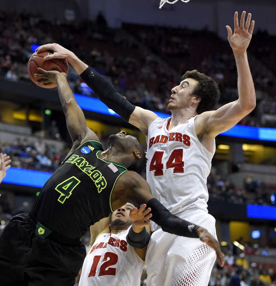 Baylor guard Gary Franklin (4) has a shot stopped by Wisconsin forward Frank Kaminsky (44) during an NCAA men's college basketball tournament regional semifinal, Thursday, March 27, 2014, in Anaheim, Calif. Photo: Mark J. Terrill, Associated Press