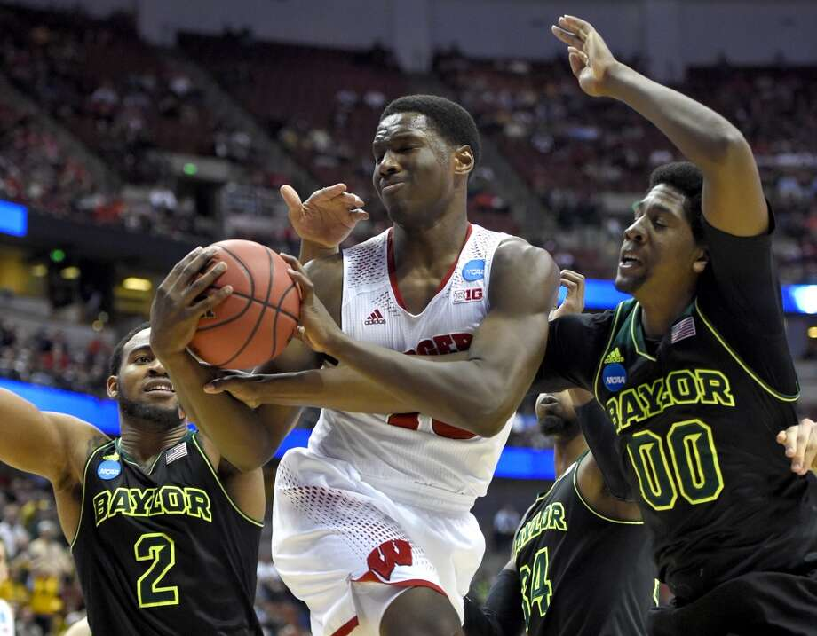 Wisconsin forward Nigel Hayes fights for a rebound against Baylor's Royce O'Neale (00) during the first half of an NCAA men's college basketball tournament regional semifinal, Thursday, March 27, 2014, in Anaheim, Calif. Photo: Mark J. Terrill, Associated Press