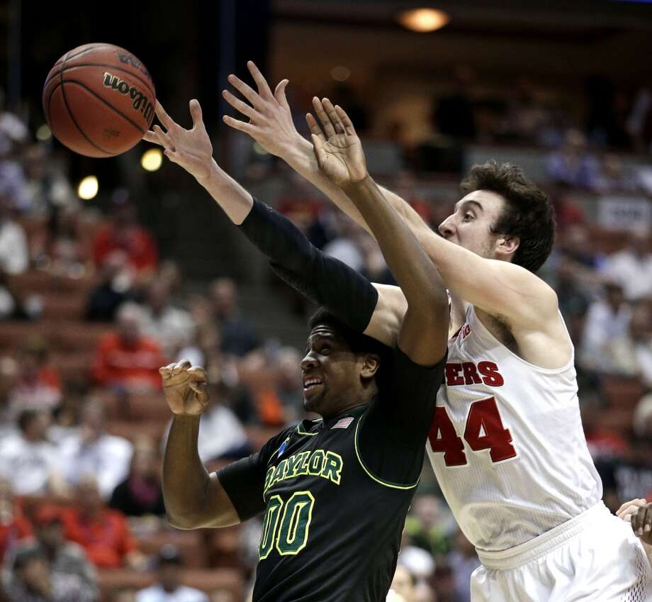 Wisconsin forward Frank Kaminsky (44) reaches over Baylor forward Royce O'Neale (00) during the second half in an NCAA men's college basketball tournament regional semifinal, Thursday, March 27, 2014, in Anaheim, Calif. Photo: Jae C. Hong, Associated Press