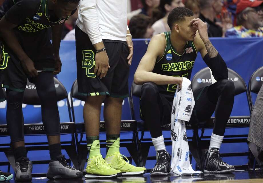 Baylor center Isaiah Austin sits on the bench during the first half in a regional semifinal NCAA college basketball tournament game against Wisconsin, Thursday, March 27, 2014, in Anaheim, Calif. Photo: Jae C. Hong, Associated Press