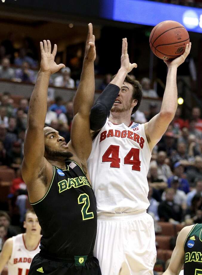 Wisconsin forward Frank Kaminsky (44) shoots over Baylor forward Rico Gathers (2) during an NCAA men's college basketball tournament regional semifinal, Thursday, March 27, 2014, in Anaheim, Calif. Photo: Jae C. Hong, Associated Press