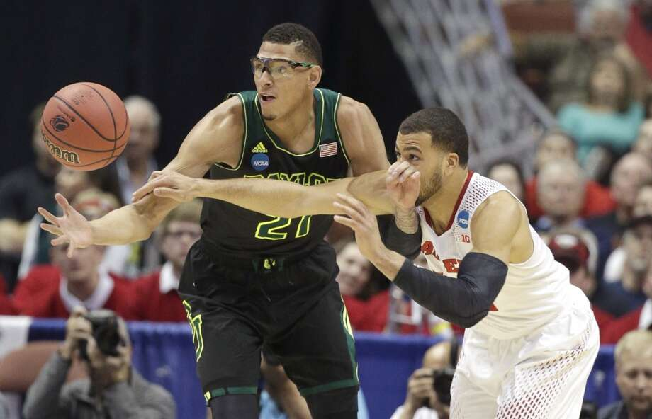 Baylor center Isaiah Austin, left, and Wisconsin guard Traevon Jackson reach for the ball during an NCAA men's college basketball tournament regional semifinal, Thursday, March 27, 2014, in Anaheim, Calif. Photo: Jae C. Hong, Associated Press
