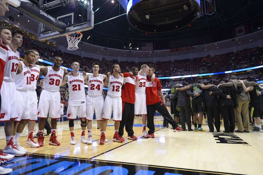 Wisconsin players stand together as the Baylor huddles up after a regional semifinal NCAA college basketball tournament game, Thursday, March 27, 2014, in Anaheim, Calif. Wisconsin won 69-52. Photo: Mark J. Terrill, Associated Press