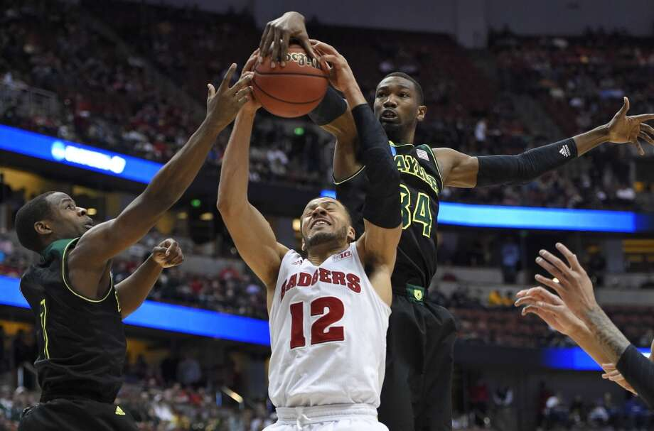 Wisconsin guard Traevon Jackson (12) competes against Baylor forward Cory Jefferson (34) for a rebound during the second half of an NCAA men's college basketball tournament regional semifinal,Thursday, March 27, 2014, in Anaheim, Calif. Photo: Mark J. Terrill, Associated Press