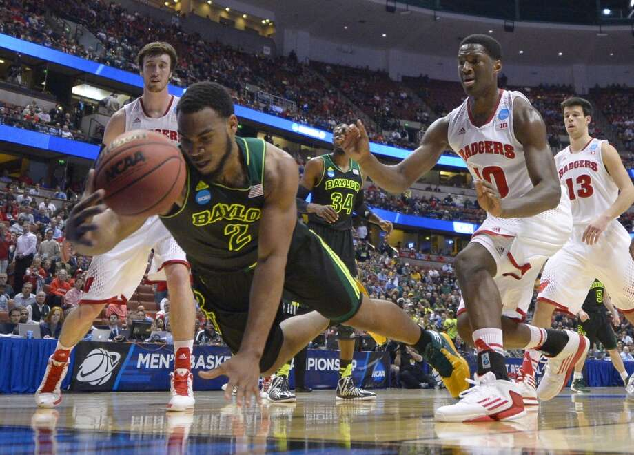 Baylor forward Rico Gathers (2) dives for a loose ball during the first half against Wisconsin in an NCAA men's college basketball tournament regional semifinal, Thursday, March 27, 2014, in Anaheim, Calif. Photo: Mark J. Terrill, Associated Press