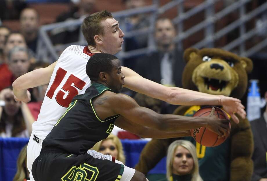 Wisconsin forward Sam Dekker (15) and Baylor guard Kenny Chery reach the ball during the first half of an NCAA men's college basketball tournament regional semifinal, Thursday, March 27, 2014, in Anaheim, Calif. Photo: Mark J. Terrill, Associated Press