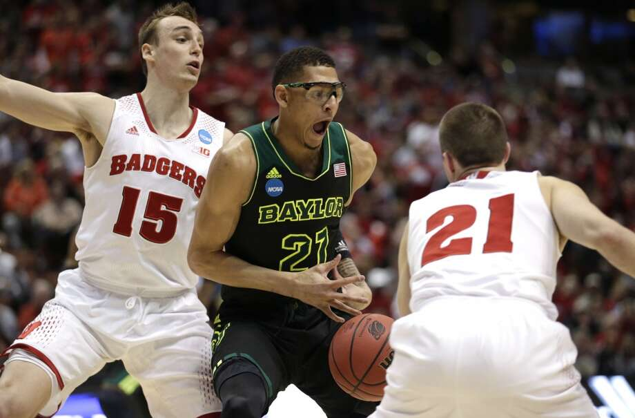 Baylor center Isaiah Austin (21) is pressured by Wisconsin's Sam Dekker (15) and Josh Gasser (21) during the second half of an NCAA men's college basketball tournament regional semifinal, Thursday, March 27, 2014, in Anaheim, Calif. Photo: Jae C. Hong, Associated Press