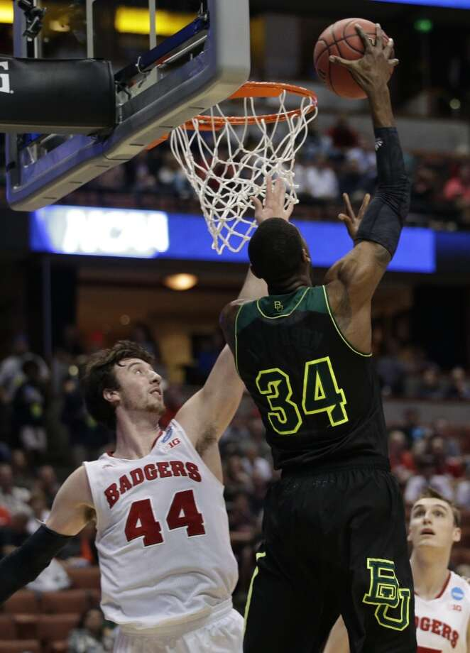 Baylor forward Cory Jefferson (34) dunks over Wisconsin forward Frank Kaminsky (44) during the second half in a regional semifinal NCAA college basketball tournament game, Thursday, March 27, 2014, in Anaheim, Calif. Photo: Jae C. Hong, Associated Press
