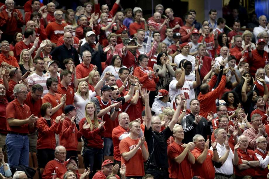 Wisconsin fans cheer during the first half in a regional semifinal NCAA college basketball tournament game against Baylor, Thursday, March 27, 2014, in Anaheim, Calif. Photo: Jae C. Hong, Associated Press