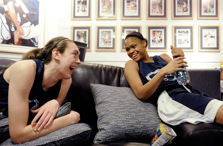 Connecticut's Breanna Stewart, left, and Moriah Jefferson share a light moment in their locker room before practice for a first-round game in the NCAA women's college basketball tournament, Saturday, March 22, 2014, in Storrs, Conn. Connecticut practices in advance of Sunday's game against Prairie View A&M. (AP Photo/Jessica Hill) Photo: Jessica Hill, Associated Press / Associated Press