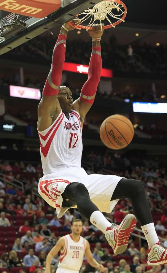 March 27: Rockets 120, 76ers 98  Rockets center Dwight Howard dunks. Photo: Johnny Hanson, Houston Chronicle