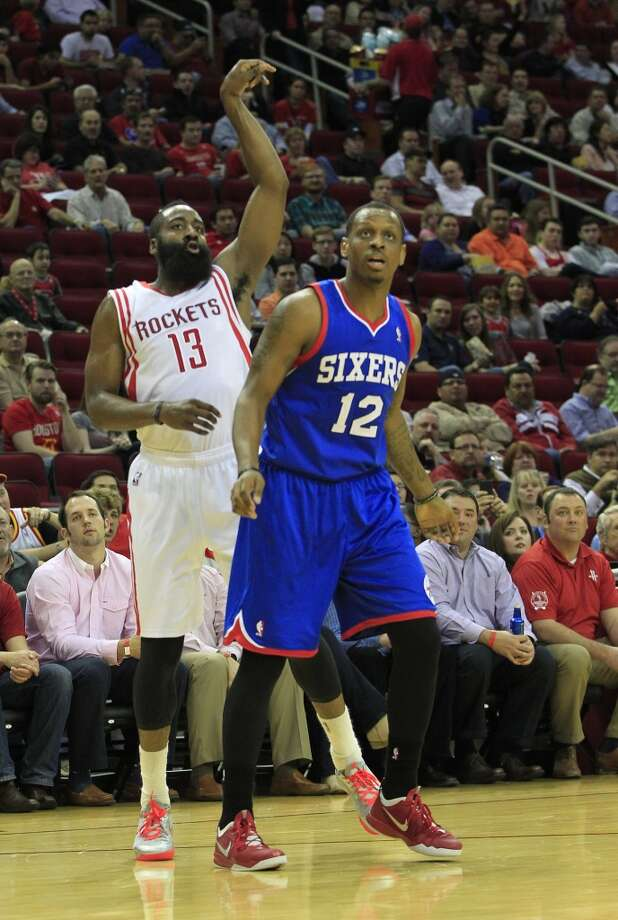 Rockets guard James Harden shoots a three-pointer over 76ers forward James Nunnally. Photo: Johnny Hanson, Houston Chronicle