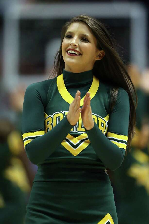ANAHEIM, CA - MARCH 27:  A Baylor Bears cheerleader performs while the Bears take on the Wisconsin Badgers during the regional semifinal of the 2014 NCAA Men's Basketball Tournament at the Honda Center on March 27, 2014 in Anaheim, California. Photo: Jeff Gross, Getty Images / 2014 Getty Images