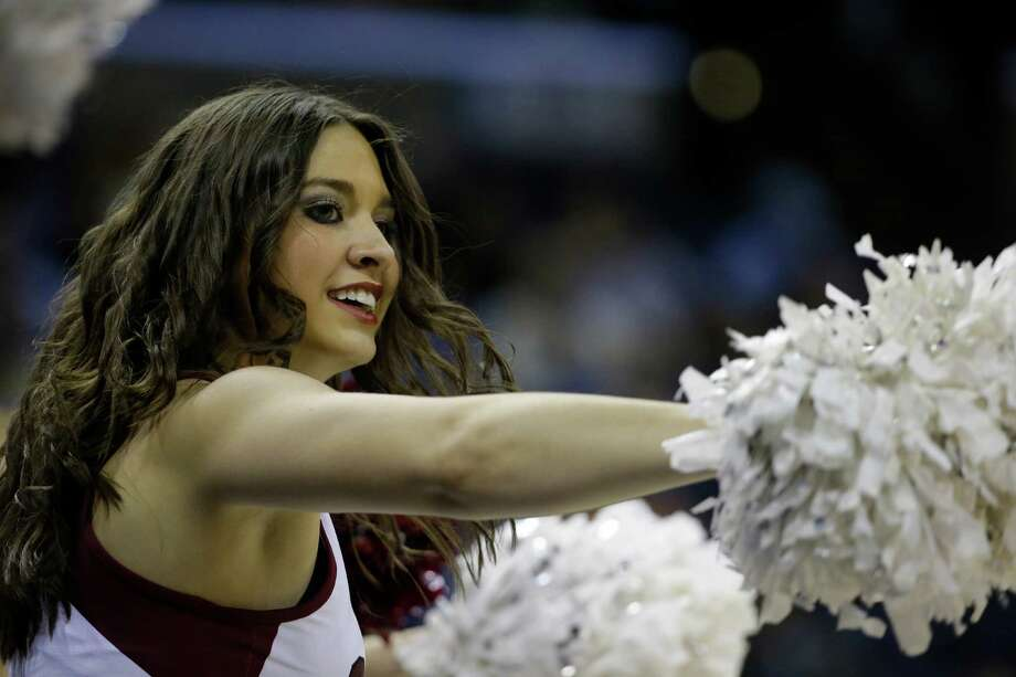 Stanford cheerleaders perform against Dayton during the first half in a regional semifinal game at the NCAA college basketball tournament, Thursday, March 27, 2014, in Memphis, Tenn. (AP Photo/Mark Humphrey) Photo: Mark Humphrey, Associated Press / AP
