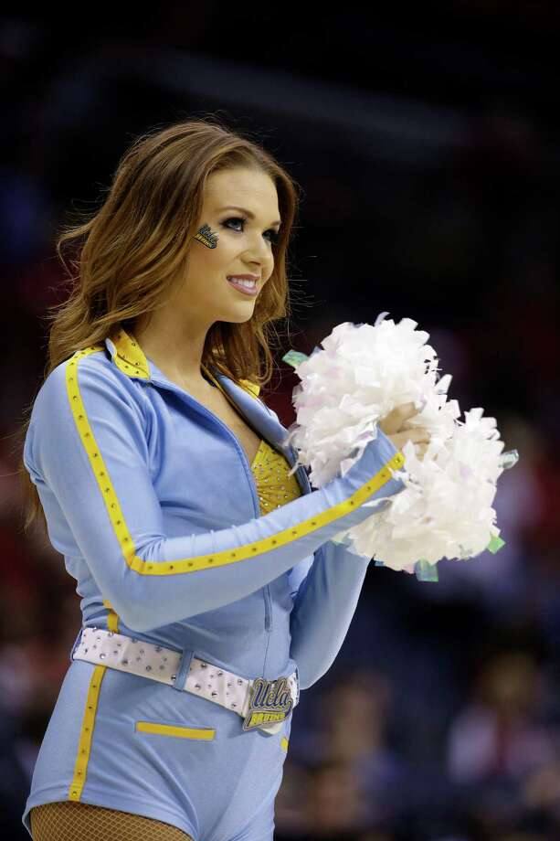 UCLA cheerleaders perform against the Florida during the first half in a regional semifinal game at the NCAA college basketball tournament, Thursday, March 27, 2014, in Memphis, Tenn. (AP Photo/Mark Humphrey) Photo: Mark Humphrey, Associated Press / AP